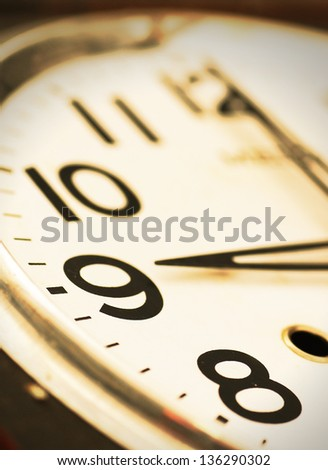 Close-up of clock face in vintage color - stock photo
