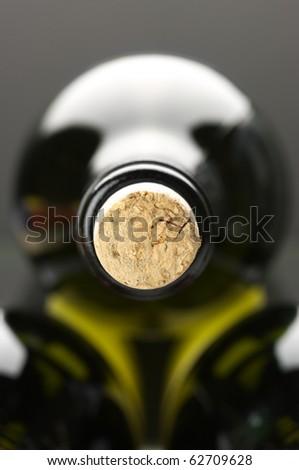 Close-up of closed wine bottles lying on dark background. - stock photo