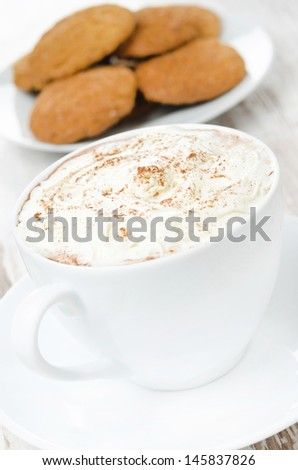 close-up of cocoa with cinnamon, whipped cream and oatmeal cookies, vertical - stock photo