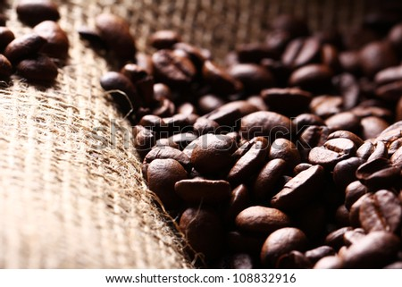Close up of coffee beans on cloth sack - stock photo