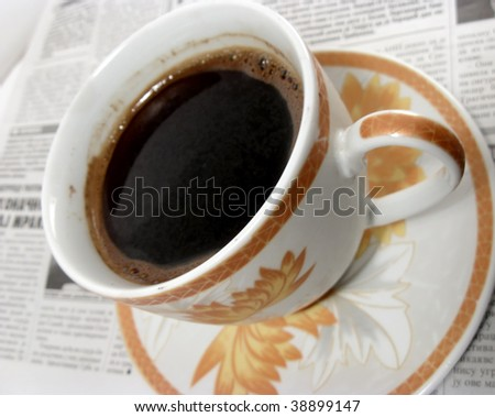 Close up of coffee cup on the newspaper - stock photo
