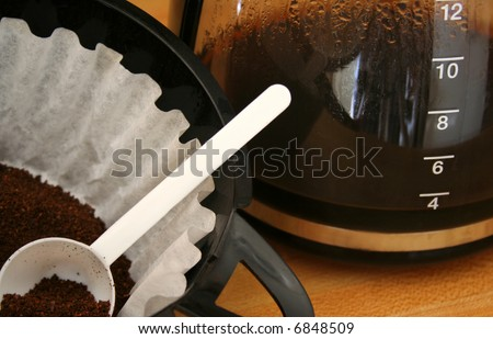 close up of coffee filter with grains and coffee pot - stock photo