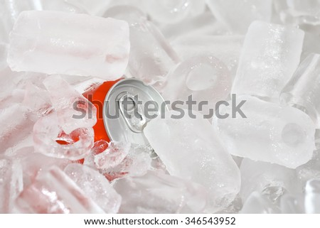 Close Up of Cola Cans in Ice - stock photo