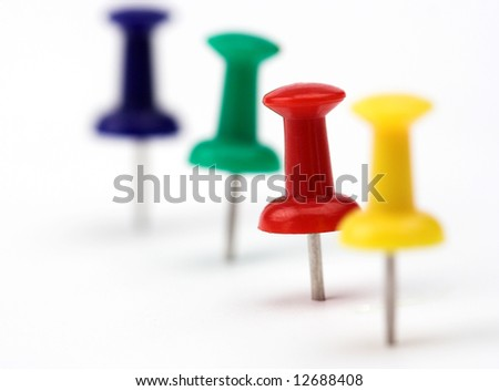 Close up of color pushpins with  shallow DOF