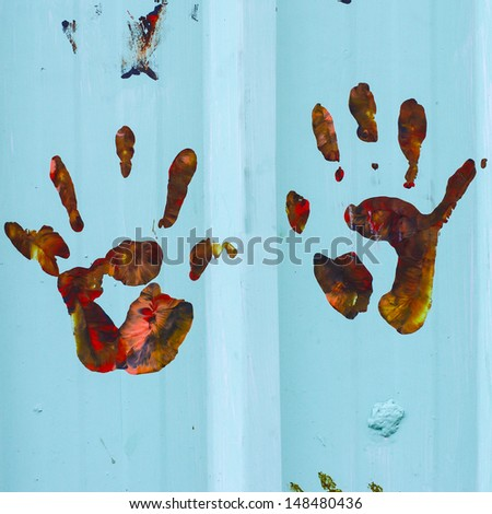 Close up of colored hand print on wall. - stock photo