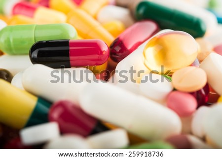 Close up of colored pills on background - stock photo