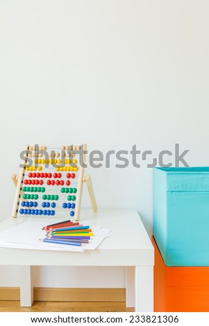Close-up of colorful abacus on the desk - stock photo