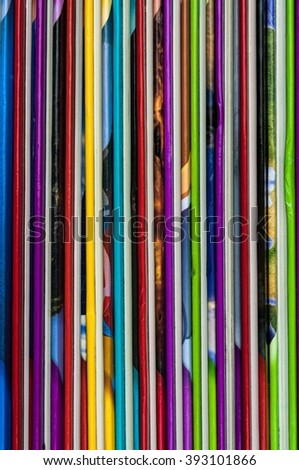 Close up of colorful children encyclopedia fore edges, vertical, abstract