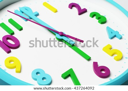 Close up of Colorful Clock Face Showing Six O'clock in the Morning - stock photo