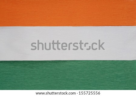 Close-up of colorful papers representing Indian flag - stock photo