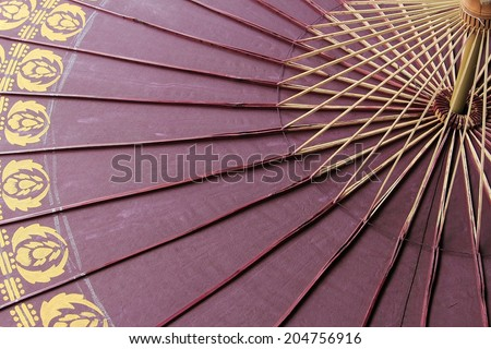 Close up of colorful umbrellas with wooden handle at Bo Sang Umbrella Village, Chiang Mai Mai, Thailand - stock photo