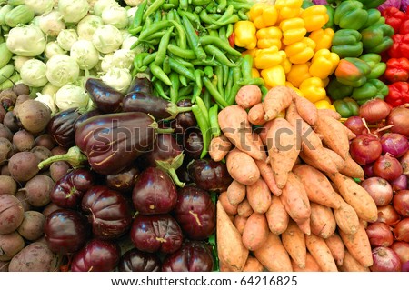 close up of colorful vegetables on market stand - stock photo