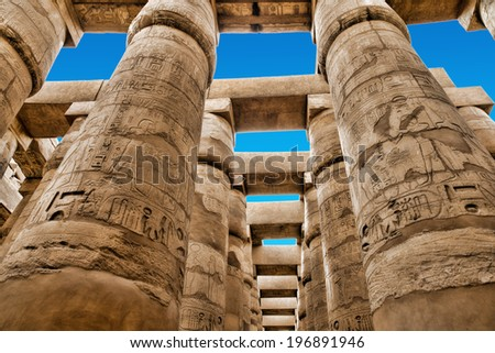 Close up of columns covered in hieroglyphics, Karnak, Egypt. - stock photo