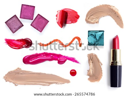 close up of complete set of cosmetics on white background - stock photo