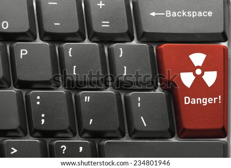 Close-up of Computer keyboard,  with Radiation Danger key - stock photo
