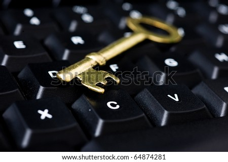 close up of computer with key. internet and network security concept. - stock photo