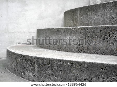 close up of concrete circle staircase in house - stock photo