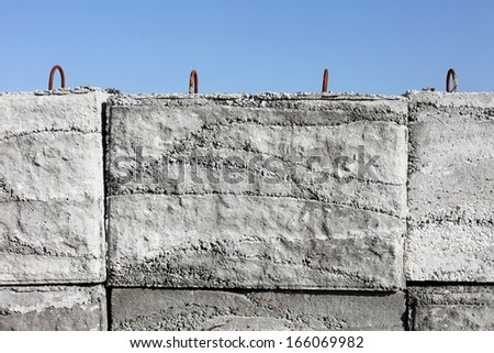 close up of concrete weight against a blue sky  - stock photo