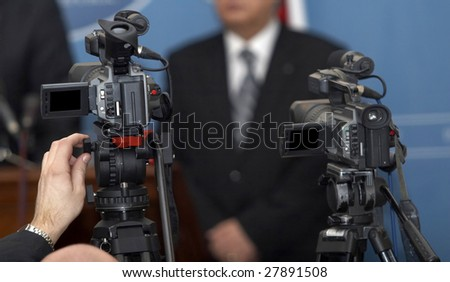 close up of conference meeting and broadcasting camera - stock photo