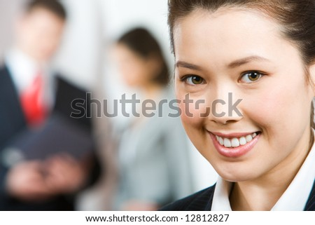 Close-up of confident beautiful businesswoman on the background of people - stock photo