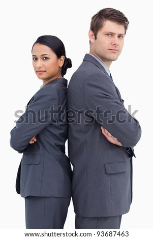 Close up of confident salesteam standing back to back against a white background - stock photo