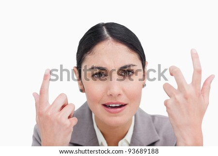 Close up of confused looking businesswoman against a white background - stock photo
