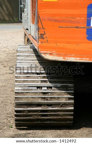 Close up of construction vehicle track - stock photo