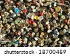 Close-up of consumed chewing gums and bubble gums stuck on a wall - stock photo