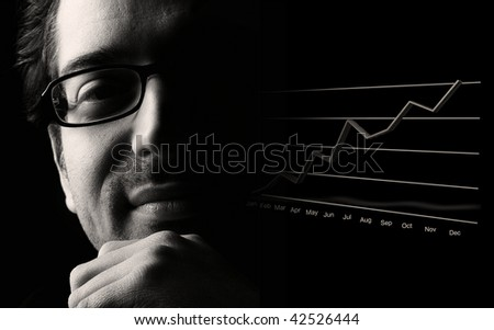 Close-up of content male professional being happy about prosperous business outlook, low key, black and white