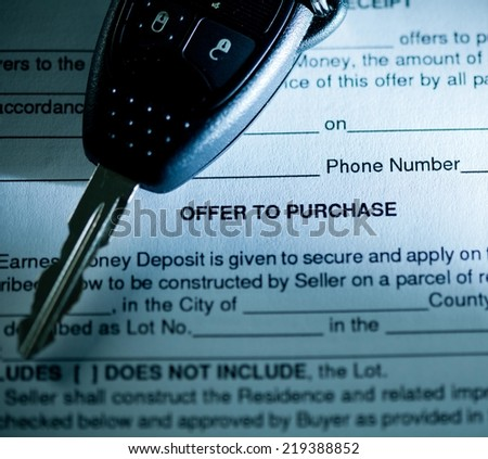 Close up of contract and car key. - stock photo