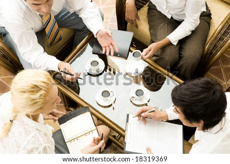 Close â??up of conversation of confident businesspeople in the room - stock photo