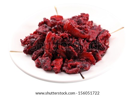 Close up of cooked red vinasse pork meat over white backgroud. - stock photo