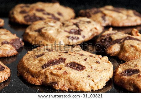 Close up of cookies on a baking tin - stock photo