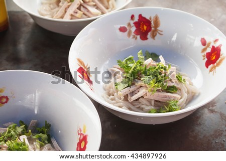 Close up of Cooking Vietnamese noodle with soup containing rice vermicelli.