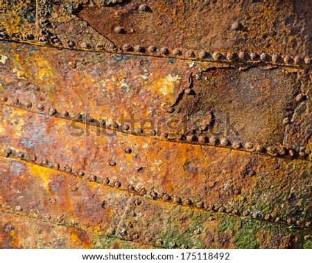 Close up of corroded iron plates and rivets on a wrecked ship. Background. - stock photo