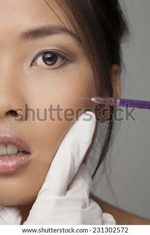 Close-up of cosmetic injection of botox - stock photo