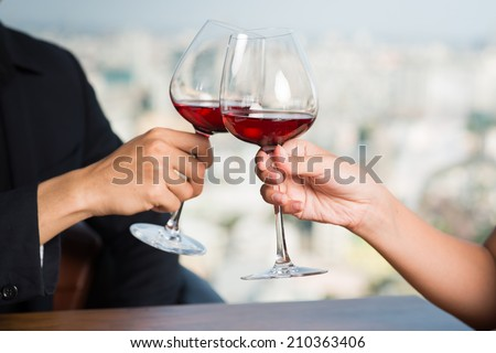 Close-up of couple drinking red wine in the restaurant - stock photo