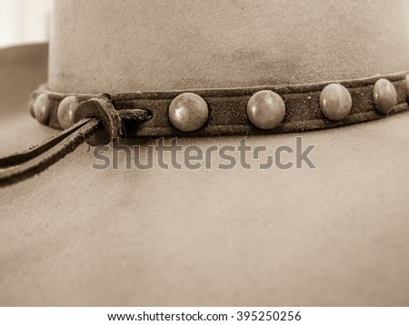 Close up of cowboy hat with studded leather hat band - stock photo