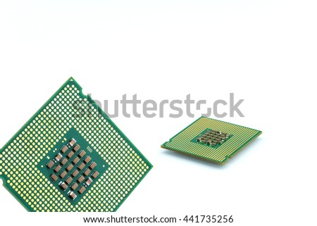 Close up of CPU microchip isolated on white background ; brians of computer. silicone chip showing mounting pins   - stock photo