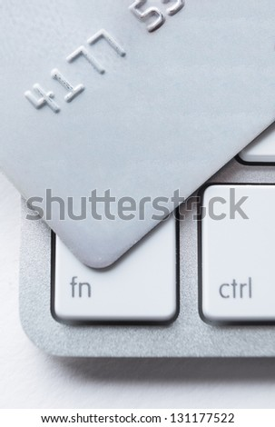 Close up of credit card on a laptop keyboard. Concept of internet shopping