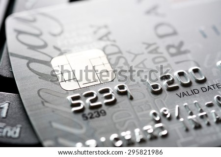 Close up of credit card with chip and numbers, gray and silver theme - stock photo