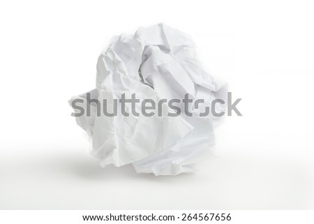 close-up of crumpled paper ball on white background