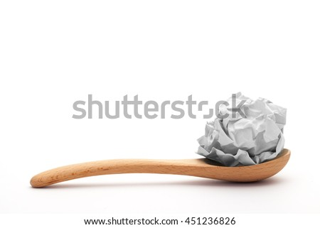 close-up of crumpled paper ball, Wadded paper on spoon - stock photo