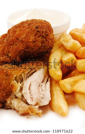 close up of crunchy breaded southern fried chicken with fries