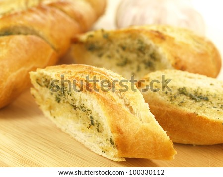 Close up of crunchy garlic baguette cut in slices - stock photo