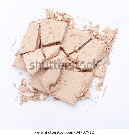 Close up of crushed facial powder on white background - stock photo