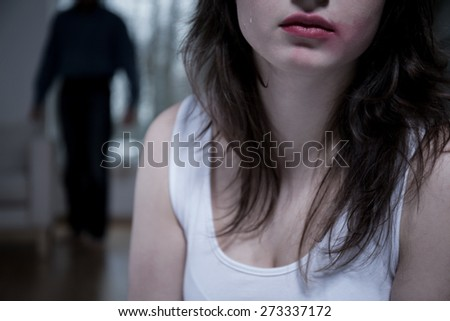 Close-up of crying woman with smudged makeup - stock photo