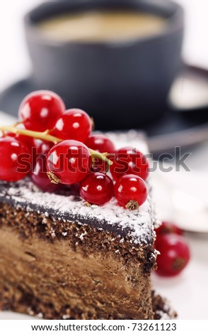 Close-up of cup of coffee and chocolate cake - stock photo