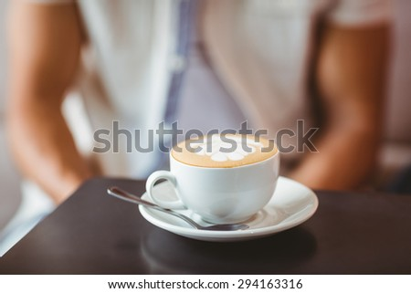 Close up of cup of coffee on table