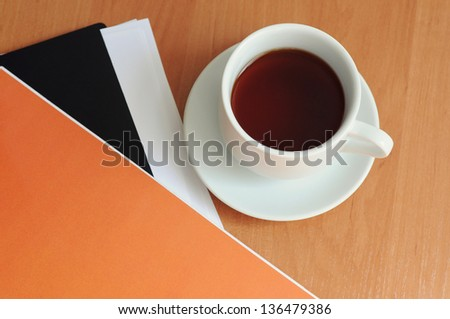Close-up of cup of coffee on the table - stock photo